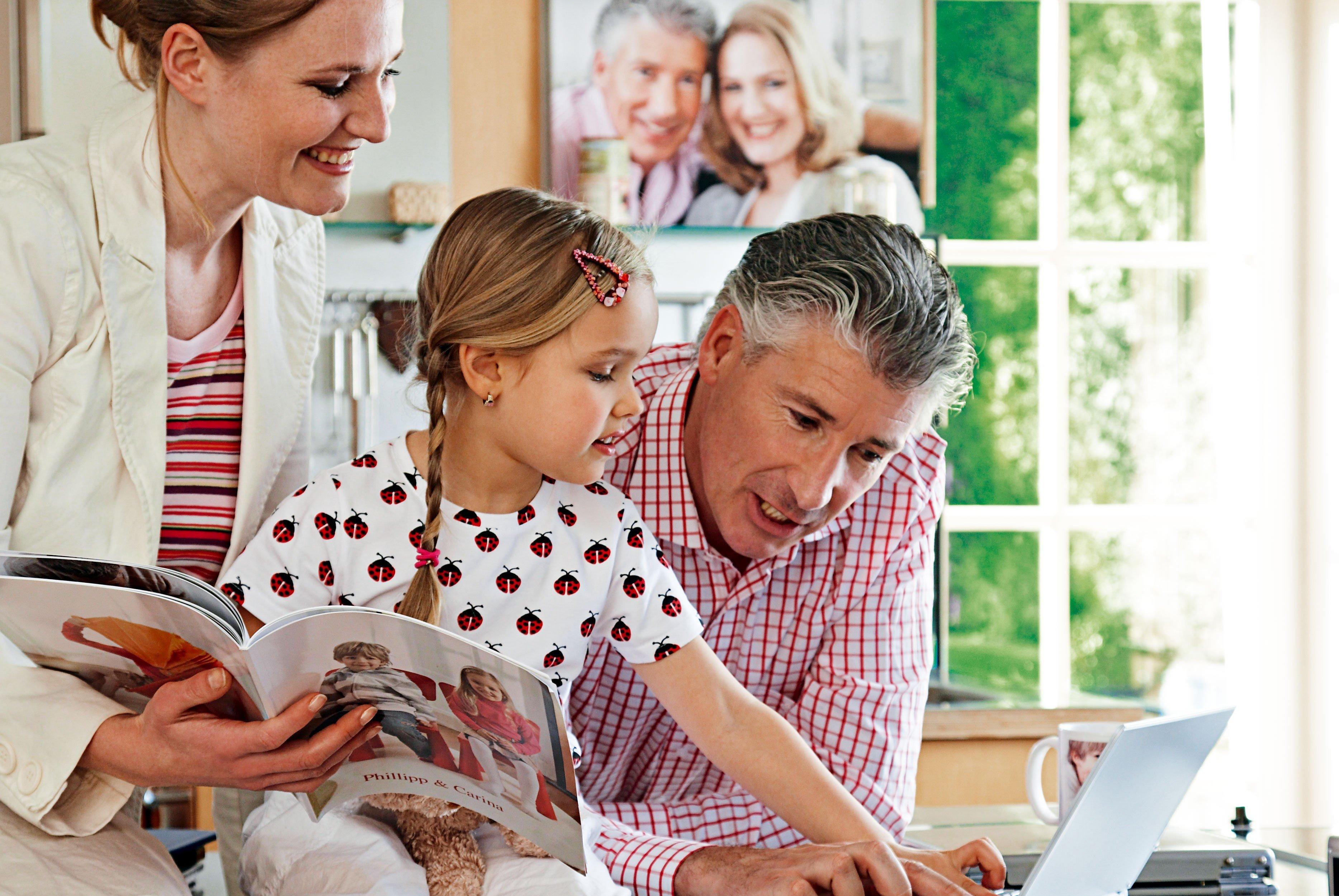 Urlaubserinnerungen konservieren - das geht am besten mit einem Fotobuch. © CEWE Fotobuch